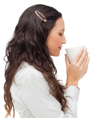 Woman holding warm cup of coffee